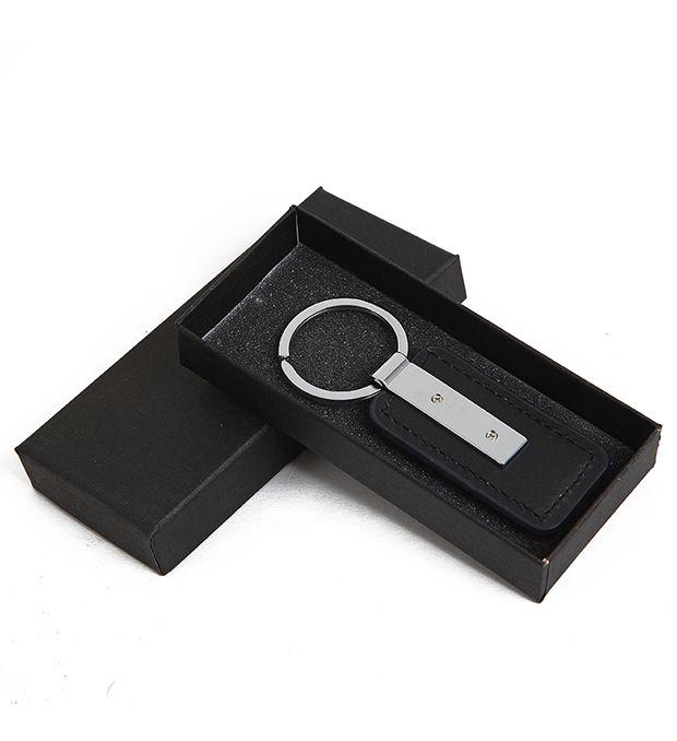 Llavero hombre PU y metal en caja x1u